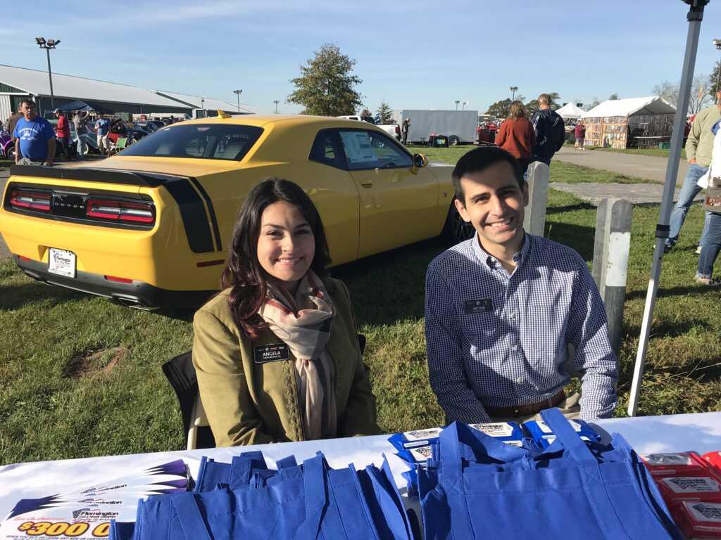 Angela Karas and Victor Belisle with Yellow Dodge Challenger