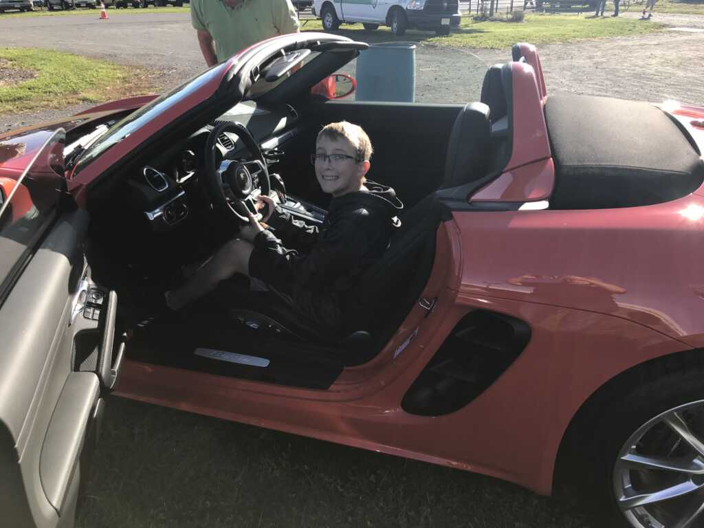 Boy in Red Porsche 718 Boxster